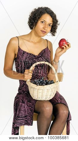 Beautiful mulatto girl with a basket of fruit