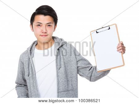 Young man show with the blank page of clipboard