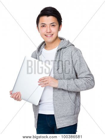 Young man hold with laptop computer