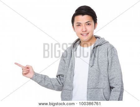 Young man with finger point aside