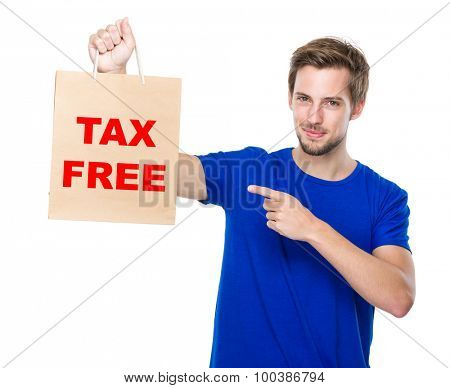 Man finger point to the shopping bag and showing phrase of tax free