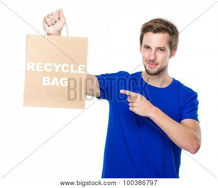 Man finger point to the shopping bag and showing phrase of recycle bag