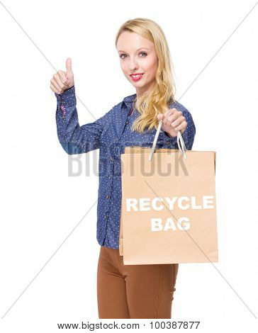 Woman with shopping bag and thumb up for showing phrase of recycle bag