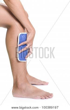Woman Applying Cold Pack On Swollen Hurting Shin