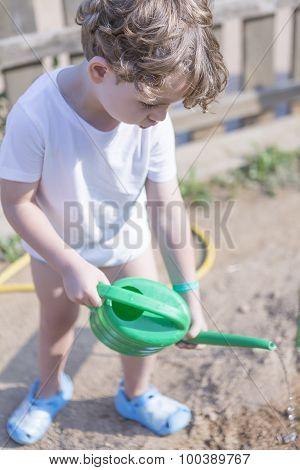 Young Boy Gardener Watering