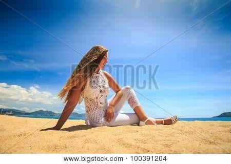 Blonde Girl In Lace In Yoga Asana Leg Cross On Beach