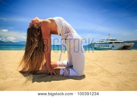 Blonde Girl Stand In Yoga Asana Back Bend Camel On Beach