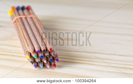 Bundle Of Pencils On A Wooden Table