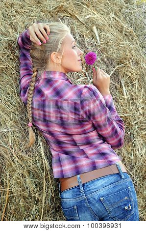Young Attractive Woman Near The Haystack