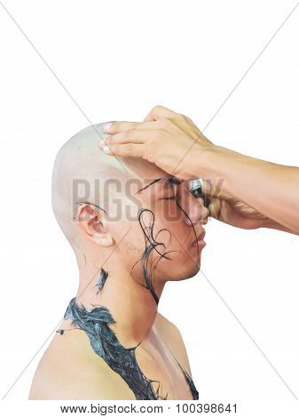 Shaving Young Man's Head