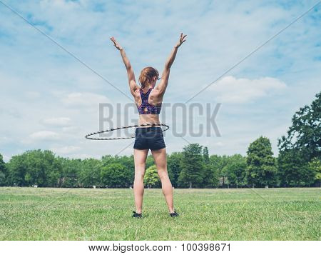 Woman Working Out With Hula Hoop