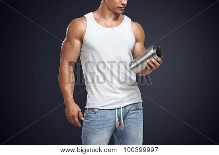 Muscular Fitness Male Model Holding Protein Shake Bottle