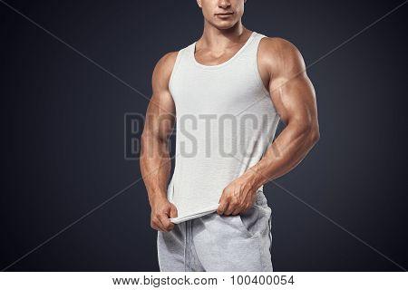 Young Bodybuilder Wearing White Sleeveless T-shirt