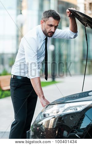 Young Businessman Having Car Trouble