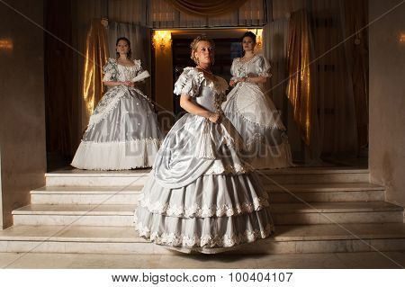 Three Young Women In Ball Gowns