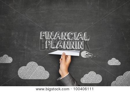 Financial planning concept on blackboard with paper plane