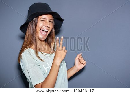 Excited Young Woman Making A V-sign Gesture