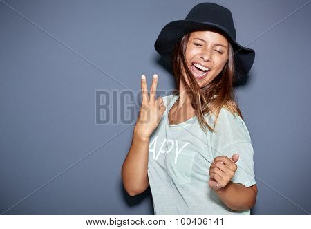 Hipster Fashionable Young Woman Giving A V-sign
