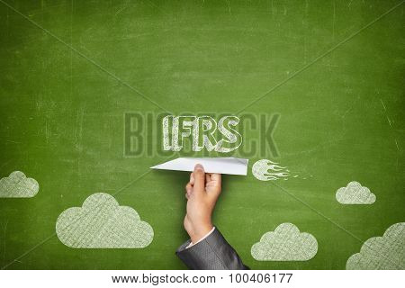 IFRS concept on blackboard with paper plane