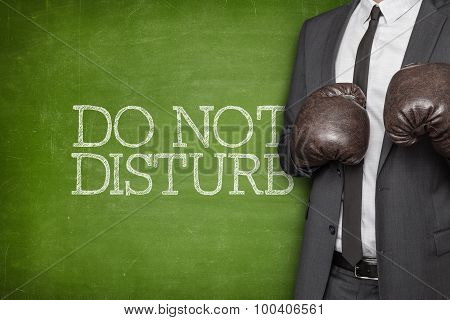 Do not disturb on blackboard with businessman on side