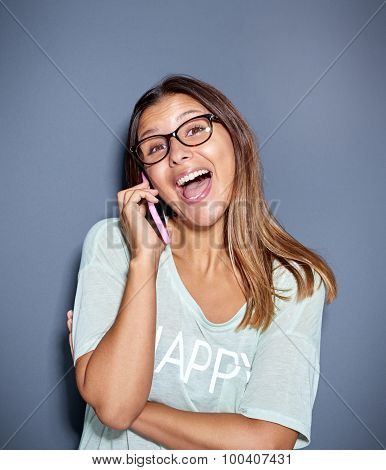 Fun Portrait Of A Laughing Woman On A Mobile