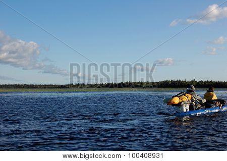Scenic view of the Karelian lake and floating tourist kayak.