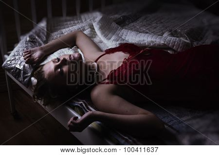 Sexual Blonde In Red Lying On A Bed