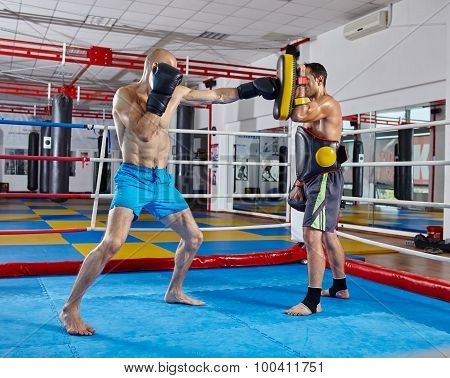 Kickbox Fighters Training In The Ring