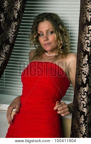 Attractive Young Woman  In A Boudoir