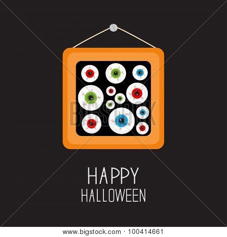 Picture Frame Hanging On The Wall Eyeballs With Bloody Streaks. Happy Halloween Card. Balck Backgrou