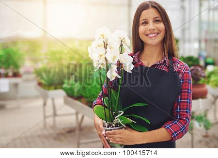 Smiling Happy Young Florist In Her Nursery