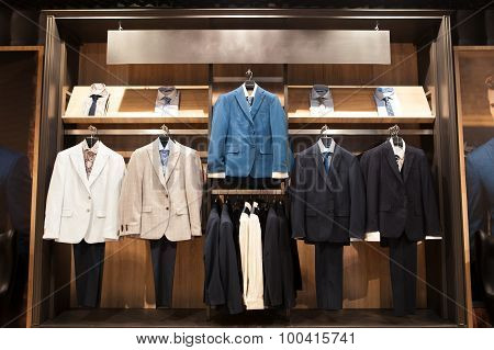 Display  With Men's Business Suits In Boutique