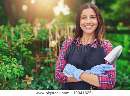 Smiling Young Nursery Owner Amongst Her Plants