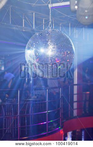 Bleu mirror ball rolling in the night club