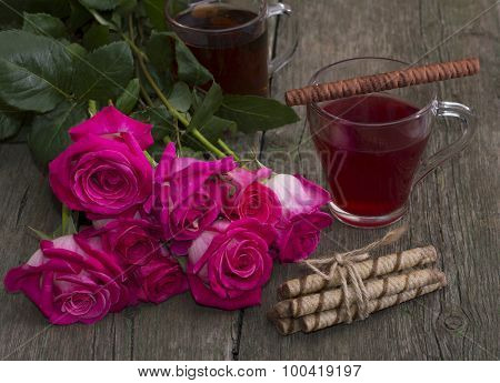 Red Roses And Two Glasses Of Tea