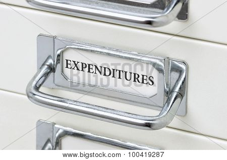 A Drawer Cabinet With The Label Expenditures
