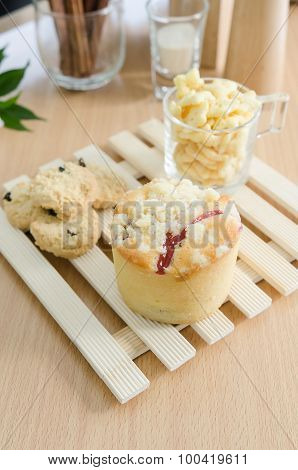 Close up of muffin and corn flakes on wooden table