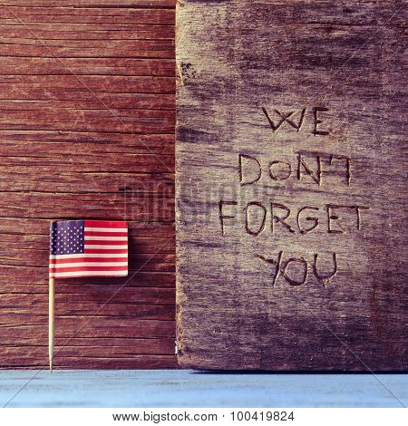 the flag of the United States and the sentence we do not forget you carved on wood
