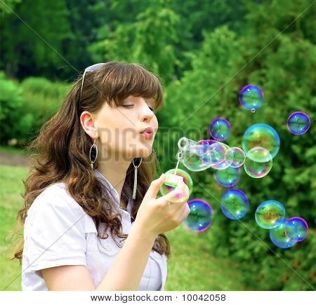 Active Young Girl With Soap-bubbles