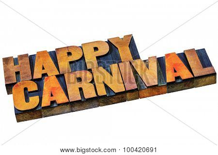 happy carnival word abstract - isolated text in letterpress wood type printing blocks stained by color inks
