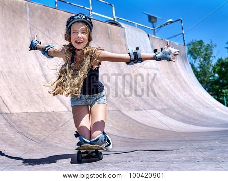 Teen girl skateboarding his skateboard outdoor.