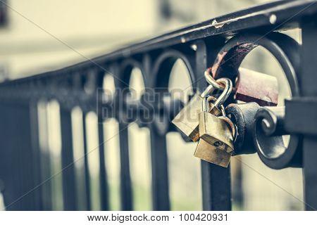 macro photo of two locks on a bridge