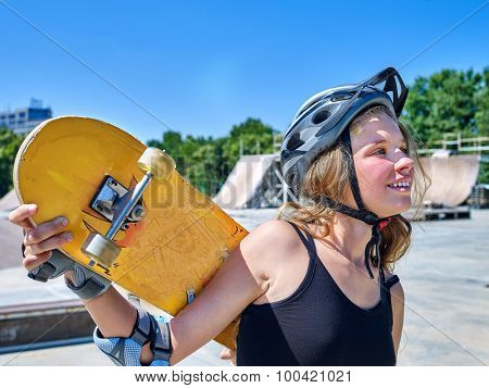 Teen skateboarding his skateboard and hold on her back outdoor. Skateboard girl style.