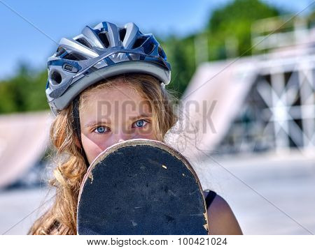 Face of teen skateboarding his skateboard outdoor. Skateboard girl style.