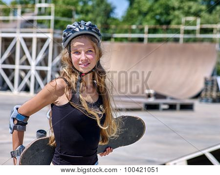 Teen skateboarding his skateboard outdoor. Skateboard girl style.