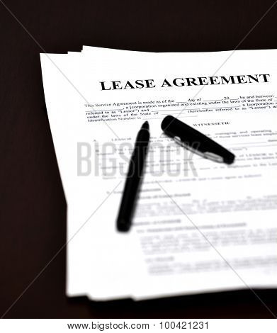 Lease document and agreement with pen for signing