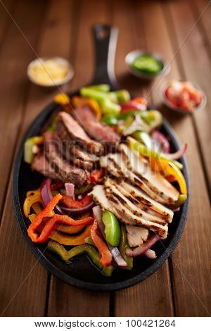 mexican steak and chicken fajitas in cast iron skillet