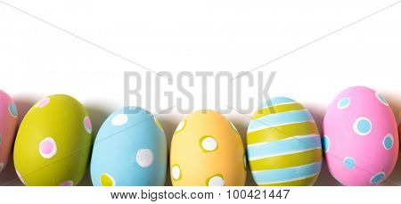 A group of colorful decorated Easter Eggs on a white background with copy space