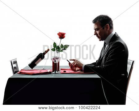 one man waiting dinning in silhouettes on white background