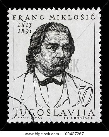 YUGOSLAVIA - CIRCA 1963: Stamp printed in Yugoslavia shows Franc Miklosic (Franz von Miklosich) (November 29, 1813 - March 7, 1891), Slovenian philologist and Slavist, circa 1963